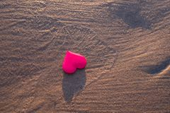 Love symbol of heart on the sea beach Stock Image