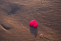 Love symbol of heart on the sea beach Royalty Free Stock Images
