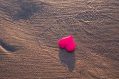 Love symbol of heart on the sea beach Royalty Free Stock Image