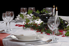 Romantic table with candles and black wine Royalty Free Stock Image