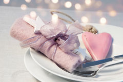 Romantic table decoration for a Christmas dinner Stock Photos
