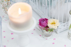 Romantic table decorations with candle and roses Stock Photo