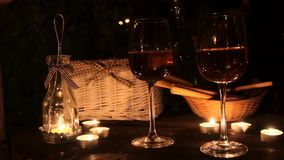 Romantic table with a lot of candles, two glasses stock footage