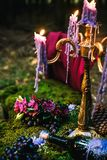 Romantic table with moss, candles dripping royalty free stock images