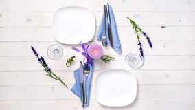 Romantic table serving with candle and flowers for two Royalty Free Stock Photo