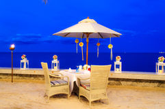 Romantic table set up dinner on the beach Stock Photography