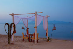 Romantic table setting. On the beach at dusk Royalty Free Stock Image