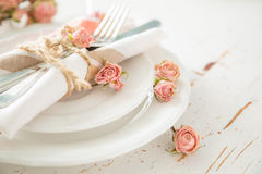 Romantic table setting with died flowers Stock Photo