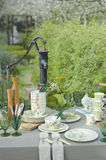 Romantic table setting in garden Stock Photos