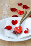 Romantic table setting with rose petals Royalty Free Stock Image