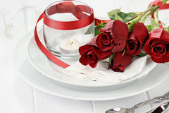 Romantic Table Setting with Roses and Candles Royalty Free Stock Photography