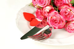 Romantic table setting with roses for the St. Valentine Stock Photo