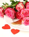 Romantic table setting with roses for the St. Valentine Royalty Free Stock Images