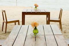 Romantic table setup on tropical beach Stock Photos