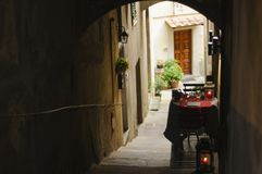 Romantic table for two in the historic center of Cortona, Tuscan stock images