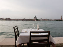 Romantic table in Venice Stock Images