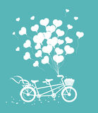 Romantic Tandem Bike with hearts balloons silhouette Stock Photo