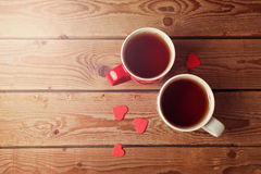 Romantic tea cups with heart shape on wooden table. View from above Royalty Free Stock Image