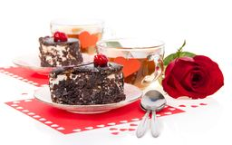 Romantic tea drinking with chocolate cakes Royalty Free Stock Image