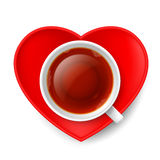 Romantic tea drinking. Cup of tea with red saucer in shape of heart Royalty Free Stock Photos