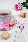 Romantic tea drinking with macaroon Royalty Free Stock Photography