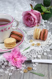 Romantic tea drinking with macaroons Royalty Free Stock Photography