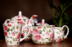 Romantic tea service. With little pink roses Royalty Free Stock Photo