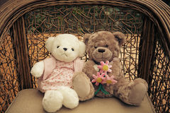 Romantic teddy-bears. Two teddy-bears sitting with in a chair Royalty Free Stock Image