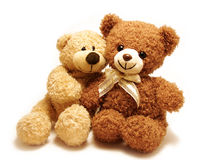 Romantic teddy-bears. Two teddy-bears sitting with their arms around each other isolated in white Stock Photography