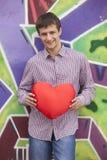 Romantic teen near graffiti wall. Stock Images