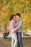 Romantic Teenage Couple. In Autumn Park Royalty Free Stock Photo