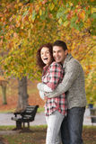Romantic Teenage Couple In Autumn Park Royalty Free Stock Photo