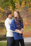 Romantic Teenage Couple In Autumn Park. Hugging Royalty Free Stock Photos