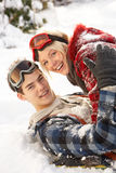 Romantic Teenage Couple Having Fun In Snow Stock Photo