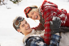 Romantic Teenage Couple Having Fun In Snow stock photography