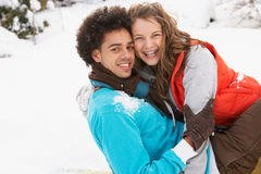 Romantic Teenage Couple Having Fun In Snow Stock Images
