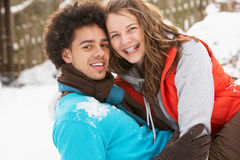 Romantic Teenage Couple Having Fun In Snow Royalty Free Stock Photo
