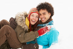 Romantic Teenage Couple Having Fun In Snow Royalty Free Stock Images