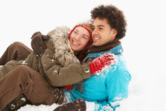 Romantic Teenage Couple Having Fun In Snow Stock Photos
