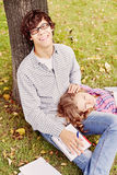 Romantic teenage couple in park stock image