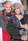 Romantic Teenage Couple In Snow Royalty Free Stock Photos