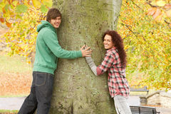 Romantic Teenage Couple By Tree Royalty Free Stock Photography