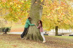 Romantic Teenage Couple By Tree. In Autumn Park Stock Image