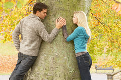 Romantic Teenage Couple By Tree. In Autumn Park Stock Photography