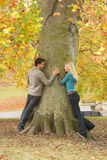 Romantic Teenage Couple By Tree. In Autumn Park Royalty Free Stock Photography