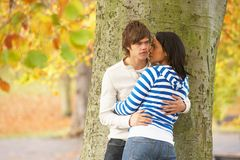 Romantic Teenage Couple By Tree In Autumn Park Royalty Free Stock Image