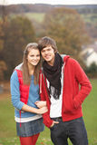 Romantic Teenage Couple Walking. Through Autumn Landscape Royalty Free Stock Images