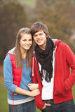 Romantic Teenage Couple Walking. Through Autumn Landscape Royalty Free Stock Photography