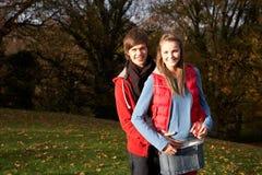 Romantic Teenage Couple Walking Through Autumn Royalty Free Stock Photo
