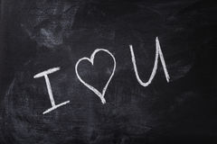 Romantic text handwritten on blackboard with chalk Stock Images